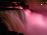 Red Lights Illuminate the American Falls in Niagara Falls  New York