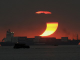 Partial Solar Eclipse as the Sun Sets at Manila's Bay  Philippines