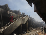 Indonesian Rescue Workers Walk on a Eartquake Damaged Building  in Padang  Indonesia