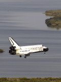 Space Shuttle Discovery Glides over the Banana River to a Landing on Kennedy Space Center's Runway