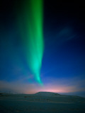 Aurora Borealis over a Snowy Landscape  Iceland