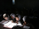Afghan School Girls Read their Lessons at the Aziz Afghan Secondary School in Kabul  Afghanistan
