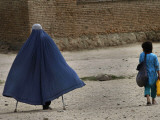 Afghan Girl Carries the Ration of Her Mother  a Victim of Land Mines  in Kabul  Afghanistan