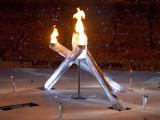 Standing with the Burning Olympic Cauldron at the Opening Ceremonies for the 2010 Winter Games