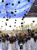 Some of 149 Graduating Cadets of Philippine Military Academy Throw their Pershing Caps in Air