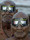 Sadhus  or Hindu Holy Men  Watch the Solar Eclipse in Allahabad  India