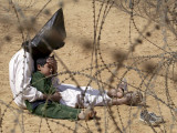 Iraqi Prisoner of War Confort His 4-Year-Old Son at a Regroupment Center for POWs Near Najaf