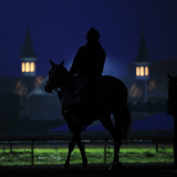 Excercise Rider Makes His Way to the Track for an Early Morning Workout at Churchill Downs