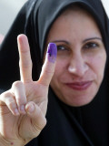 Iraqi Woman Holds Up Her Purple Finger  Indicating She Has Just Voted in Southern Iraq