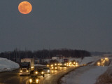 Blue Moon Rises over Interstate 80 West of Omaha  Nebraska