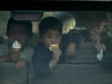 Afghan Boys Eat Ice Cream as They Sit Inside a Van in Kabul  Afghanistan