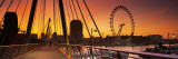 Golden Jubilee Bridge across a Thames River  Ferris Wheel in Back  London  England