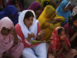 Christians Pray During a Ceremony to Celebrate Orthodox Palm Sunday  Outside a Church in Pakistan