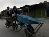 Children Push a Wheelbarrow as They Return Home in the Outskirts of Kabul  Afghanistan