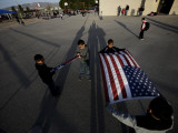 School Children Prepare to Raise the US and Texas Flags in Front of the Elementary School