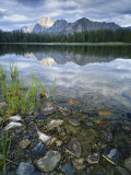 Stones Along Shore of Frog Lake with Mountain Peaks in Back  Sawtooth National Recreation Area  USA
