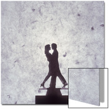 Silhouette of a Toy Couple Dancing