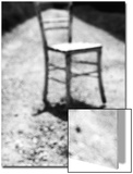 Empty Straight-Backed Chair in Spotlight