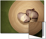 A Two One-Halfs of a Red Onion on a Wooden Plate