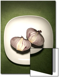 A Two One-Halfs of a Red Onion on a White Plate