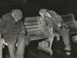 Vagrants Asleep on Bench on Thames Embankment  London