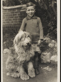 A Young Boy  Poses for His Photograph with His Pet Old English Sheepdog