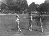 Two Boys with a Water Hose in a Devon Garden