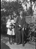 Three Children Photographed in the Garden - a Girl Holds a Doll