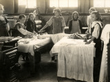 Young Girls Ironing in Laundry Room  Surrey