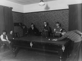 Seven Boys Play a Game of Snooker During an Evening at a Boys Club
