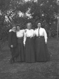 Photograph of a Young Man with His Mother and Aunts