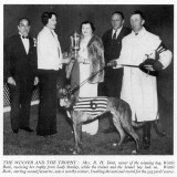 Mrs RH Dent with the Greyhound Derby Trophy and Wattle Bark