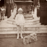 A Little Boy Dressed Entirely in White  with His Dog  in Venice