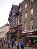 Shoppers Walking Down the Street Between the Shops at Canterbury  Kent