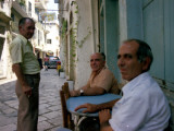 Local People Pass the Time of Day in the Town Centre of Corfu