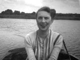Photograph of a Woman on a Rowing Boat