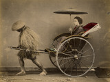 A Japanese Lady with a Parasol Rides in a Rickshaw Pulled by a Coolie