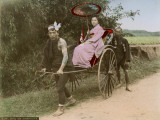 A Japanese Woman Holding a Parasol on a Rickshaw Ride