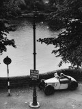 Old Man in a Small Car by the River Dee - Chester