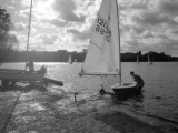 Casting Off a Small Laser Class Sailing Boat at a Boat Club in Surrey