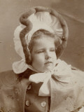 Photographic Portrait of a Young Girl in an Amazing Bonnet