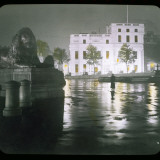 A Girl Stands in Trafalgar Square at Night