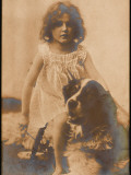 A Small Girl Poses with a Large Dog