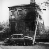 Abandoned Car and Delapidated House in Manchester