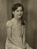 Photograph of a Young Girl with Plaits