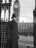 Policeman on Duty Outside the Houses of Parliament and Big Ben in London