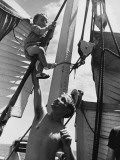 Refugees on a Ship  with Child Playing in the Rigging During World War Ii