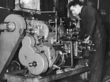 A Man Working on a Lathe in an RAF Aircraft Workshop During World War Ii