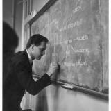A Teacher Writing on a Blackboard at Northfield House Junior School  Leicester