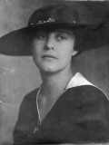 Photograph of an Elegant Woman Wearing a Hat